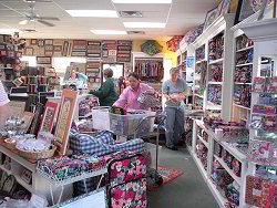 Here are Laura and Kim busy re-stocking the Vera Bradley. A never-ending job!  click for a larger view